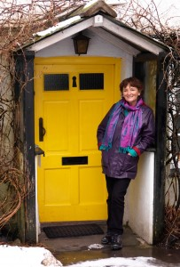 Zoe Dawes outside Anne Tyson's Cottage Grasmere