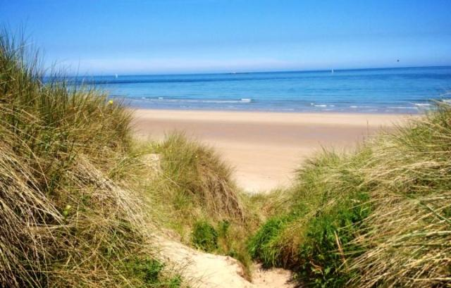 Bamburgh beach Northumberland - by Zoe Dawes