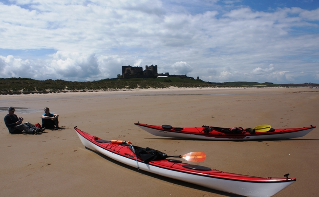 Bamburgh Castle and canoes on beach, Northumberland - image Zoe Dawes