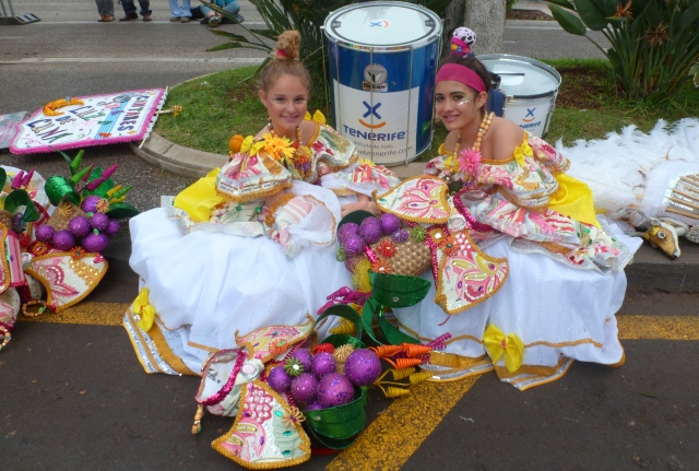 Girls sitting down Tenerife Carnival - by Zoe Dawes