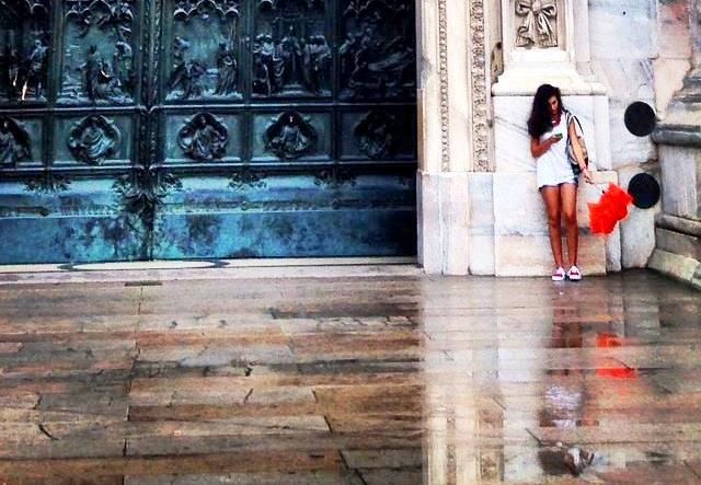 Girl with umbrella - Milan Cathedral in the rain Il Duomo Italy