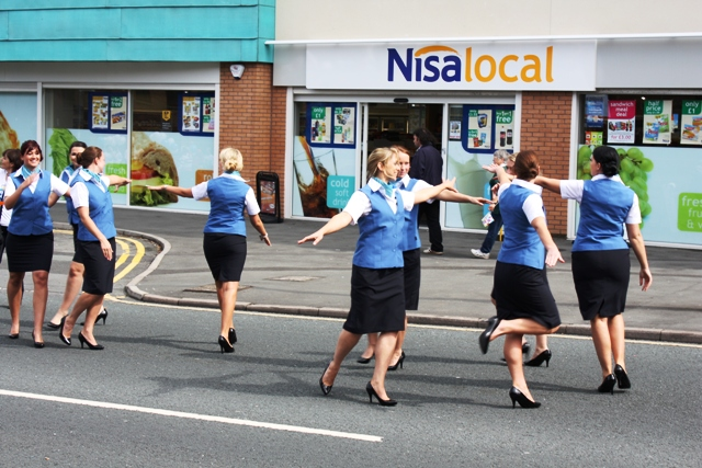 Stewardesses dancing in the street