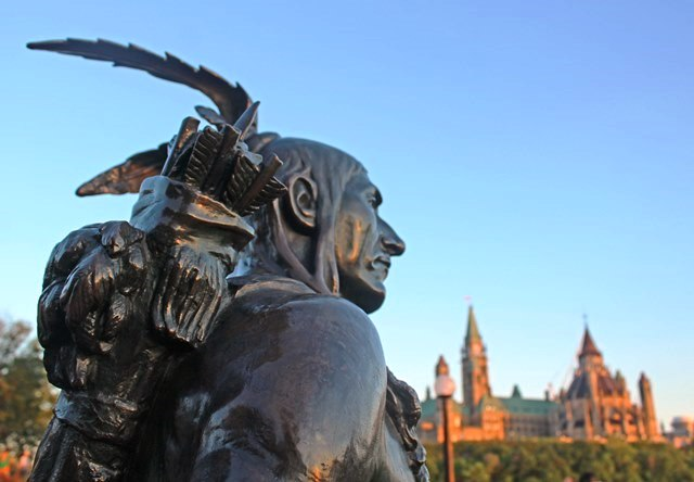 Statue of 'Anishinabe Scout' by Hamilton MacCarthy overlooking Parliament Hill Ottawa Canada 150 - photo Zoe Dawes