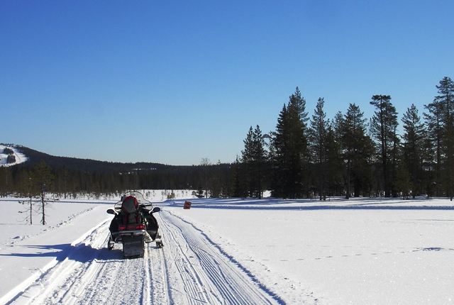 Snowmobile on frozen lake in Finland Scandinavia