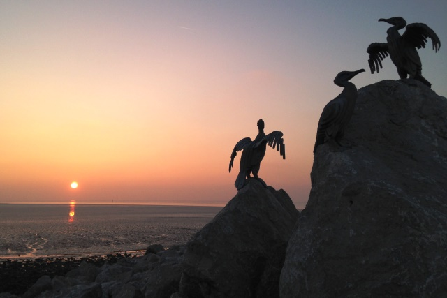 Cormorant sculpture at sunset over Morecambe Bay - photo zoedawes