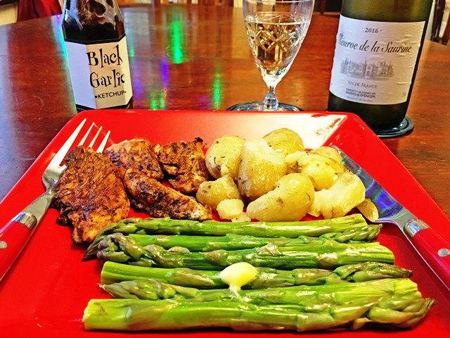 Jerk chicken, new potatoes, asparagus and Black Garlic Ketchup - photo zoe dawes