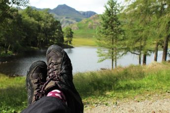 The Quirky Traveller sitting at Blea Tarn overlooking the Langdales in the Lake District World Heritage site Cumbria
