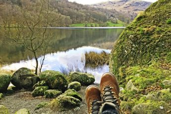 A pair of walking boots overlooking Grasmere in the Lake District - photo Zoe Dawes