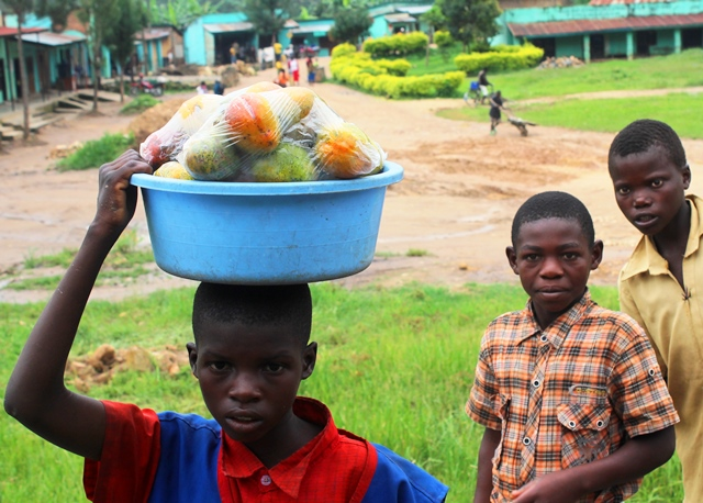 Boy selling fruit Rwanda