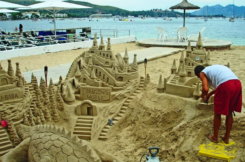 Building sandcastles on Puerto Pollensa beach Majorca