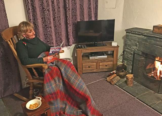 By the fire Rose Cottage Elterwater, Lake District Cumbria - Zoe Dawes