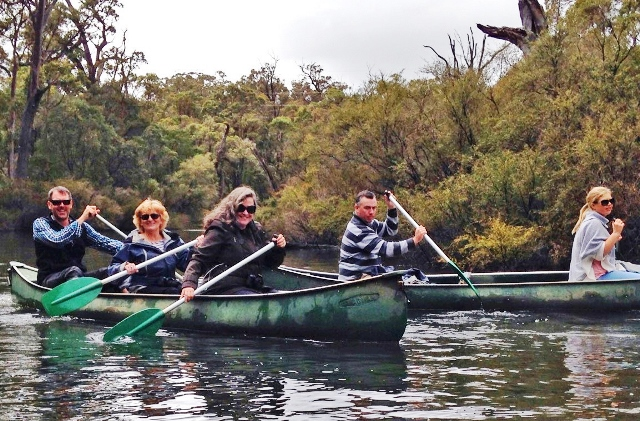 Paddling canoe on the Margaret River, Western Australia - photo zoedawes