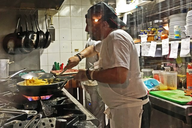 Chef cooking spaghetti carbonara at 'Le Mani in Pasta' Trastevere Rome