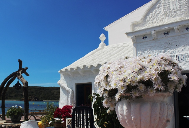 Es Grau cottage with flower pots Menorca - image zoedawes