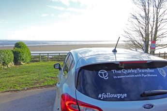 The Quirkymobile aka #FollowPye Ford Fiesta on coast road overlooking Morecambe Bay