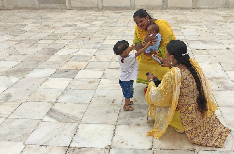 Three generations - grandmother, daughter, son and baby at the Red Fort, Agra in Rajasthan India. Photo The Quirky Traveller