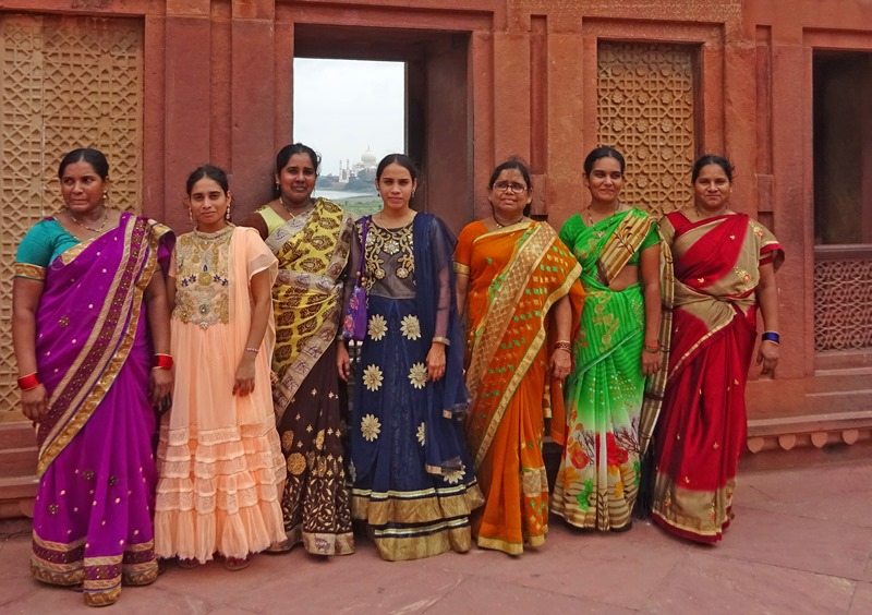 Women in colourful saris at Red Fort, Agra in India - The Quirky Traveller