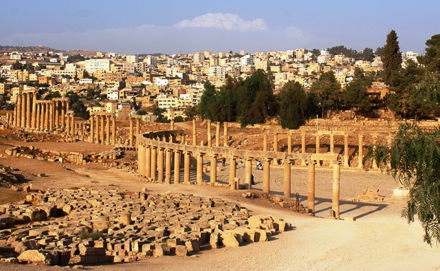 Jerash Forum and modern city Jordan - photo zoedawes