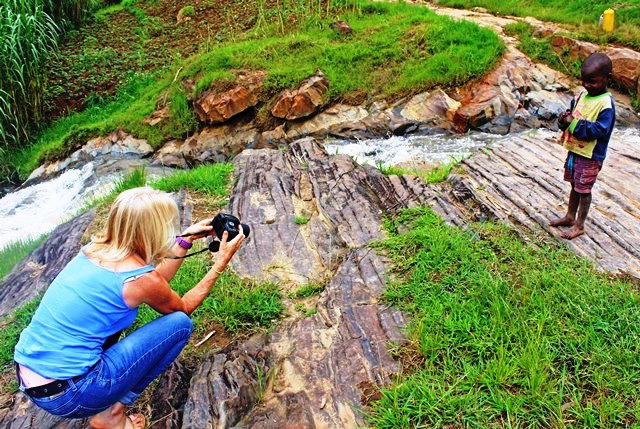 Little boy being photographed in Rwanda - The Quirky Traveller