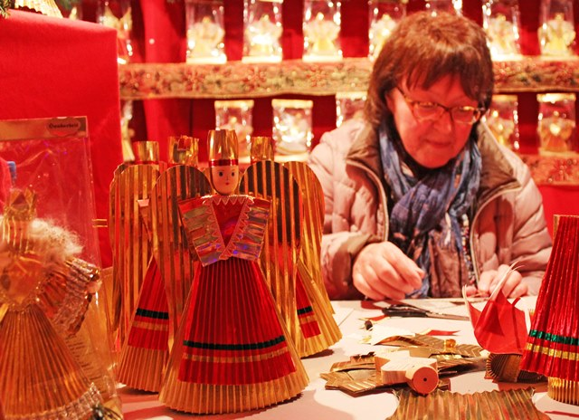 Making Christkind and angel decorations Nuremberg Christmas Market - Bavaria Germany - photo Zoe Dawes