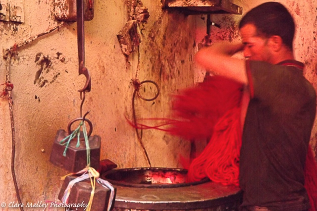 Man dyeing wool Marrakech - claremalleyphotography.com