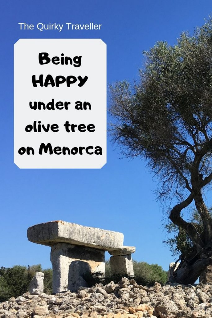 Happiness on Menorca under an olive tree near an ancient site Talati de Dalt