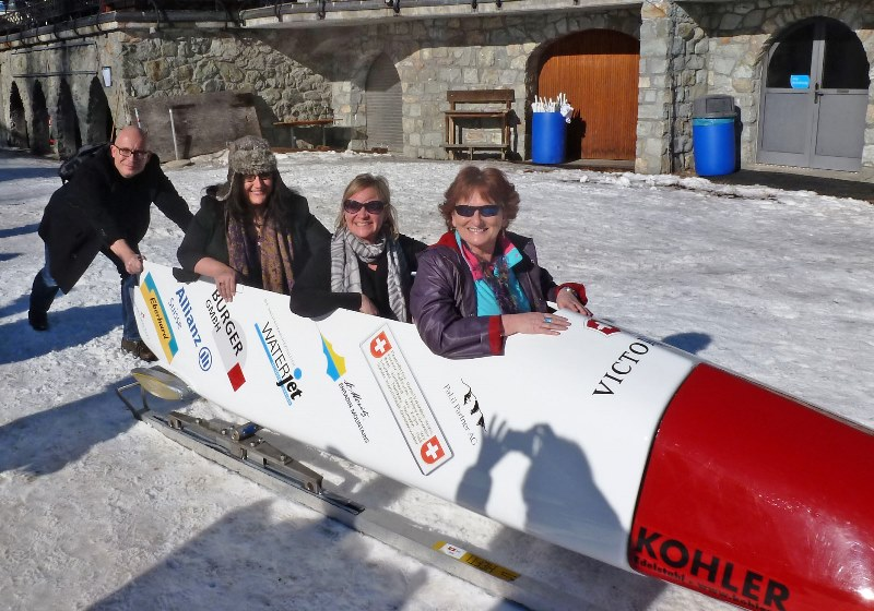 Posing in bobsled at Olympic Bob Run St Moritz - The Quirky Traveller