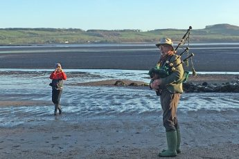 New Year's Day Scottish piper on Dhoon Beach Kirkcudbright Scotland Hogmanay - photo Zoe Dawes
