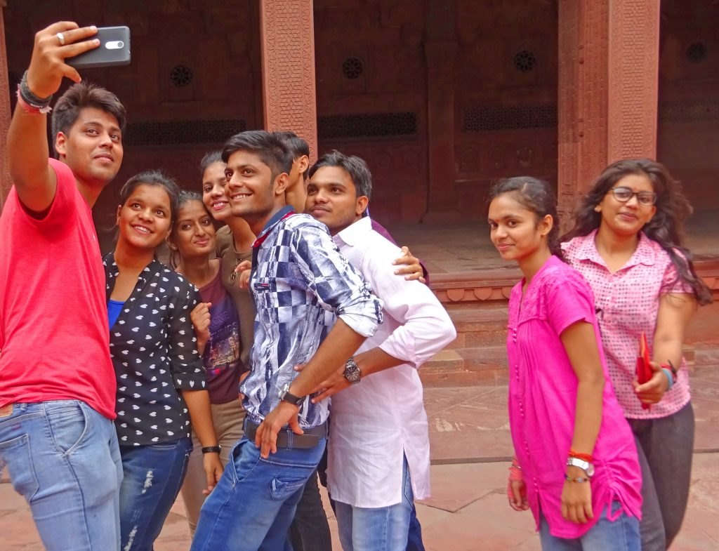Young people posing for a selfie at the Red Fort Agra in India - photo The Quirky Traveller
