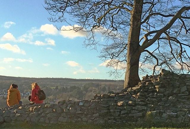 Sitting on Kendal Castle walls