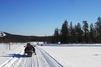 snowmobile-on-frozen-lake-finland