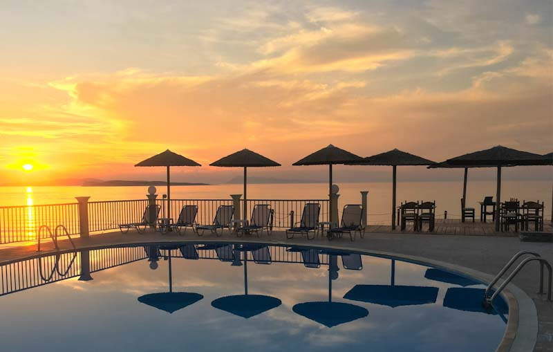 Sunset over pool at Aghios Stephanos Corfu - photo by Zoe Dawes