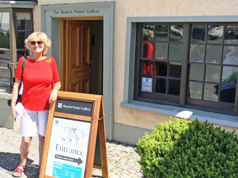Zoe Dawes in front of Beatrix Potter Gallery Hawkshead